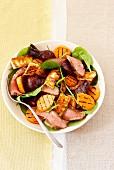 Salad with lamb, sweet potatoes, beetroot and haloumi