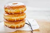 A stack of vanilla doughnuts