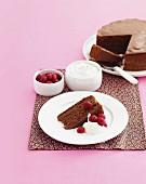 Chocolate caramel cake with raspberries and cream