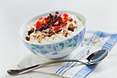 Rice pudding with grated chocolate, strawberries and cinnamon