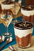White and dark chocolate mousse with chocolate glaze and gold leaf served with dessert wine