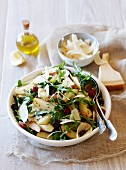 A salad with roast potatoes, grapes, fennel and parmesan