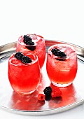 Berry drinks with ice cubes and fresh blackberries