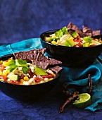 Vegetable soup with blue corn chips (Mexico)