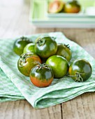 Green tomatoes on a tea towel