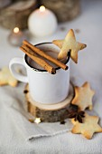A cup of hot chocolate and star-shaped sables for Christmas