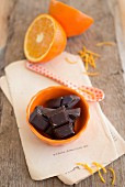 Pieces of chocolate, oranges and orange zest