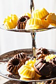 Various mini Bundt cakes on a cake stand
