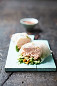 Rice paper rolls with salmon and vegetables (Asia)