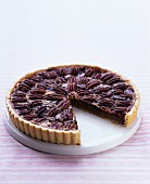 Chocolate and pecan nut tart, sliced