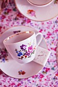 Floral-patterned teacups with a gold rim