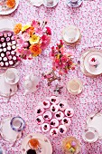A tea party with cupcakes and flowers