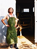 A farmer wearing an apron in front of a cowshed (Ibiza)