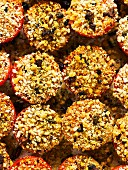 Roasted tomatoes topped with an olive and breadcrumb crust