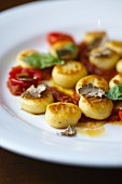 Gnocchi with tomatoes, truffles and basil