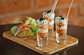 Smoked salmon with cream and caviar served in shot glasses