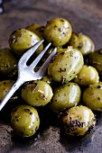 Green olives marinated in basil pesto