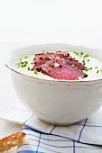 Parsnip and potato soup with raw tuna