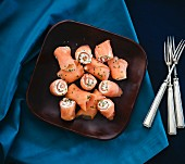 Smoked salmon rolls with cream cheese and chives