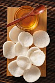 Prawn crackers on a wooden board