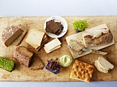 Various types of bread, fresh cress and spreads