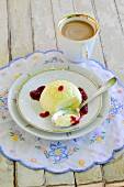 Blancmange on a plate and a cup of coffee
