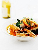 Fish soup with langoustines, cod and prawns