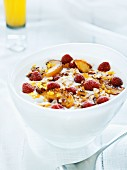 Yogurt muesli with fresh raspberries and roasted apple slices