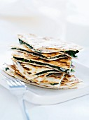 Piadina con gli spinaci (unleavened bread filled with spinach, Italy)