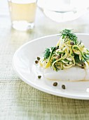 Poached cod with courgette pasta and dill