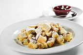 Kaiserschmarrn (shredded sugared pancake from Austria) with stewed damsons