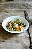 Mixed mushrooms in a creamy sauce with bread dumplings