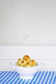 Potato dumplings with brown breadcrumbs in a round terrine