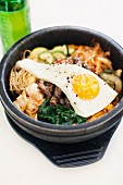Bibimbap (vegetable dish made with meat and egg, Korea)
