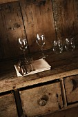 Glasses and cutlery on a rustic wooden table