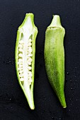 Okra pods, whole and halved