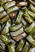 Khaw-tom (sticky rice with bananas wrapped in banana leaves and steamed, Thailand)