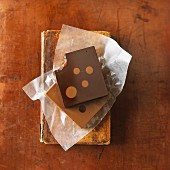 Polka dot chocolate with a bite taken out