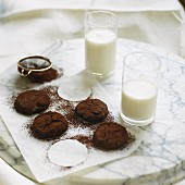 Chocolate cookies and two glasses of milk