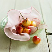 Fresh sweet cherries on a cloth on a plate