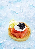 A blini topped with smoked salmon and caviar