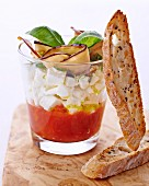 Verrine with tomato sauce and cream cheese served with slices of crispy bread
