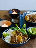 Beef curry with rice and lemons