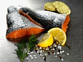 Raw salmon fillets with herb butter, lemon and dill
