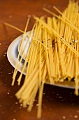 A plate of spaghetti sprinkled with pasta spices