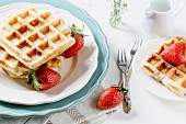 Belgian waffles served with strawberries