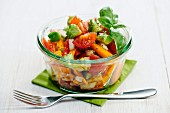 A summery vegetable salad with tomatoes, avocado and carrots