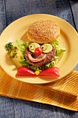 A hamburger with a funny clown face