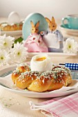 A soft-boiled egg in a bread wreath for breakfast on Easter Day