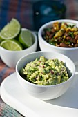 Guacamole, bean dip and limes